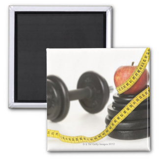 Tape measure, apple, dumbbell and weights square magnet