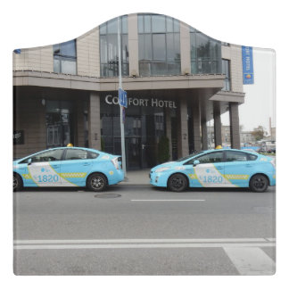 Taxi Cabs in Vilnius Lithuania Door Sign