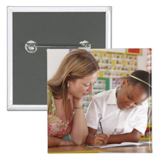 Teacher and school child working in classroom 15 cm square badge