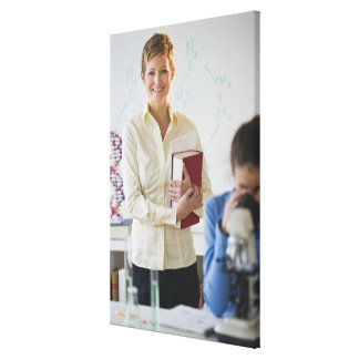 Teacher and student in science lab stretched canvas print