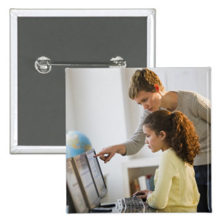Teacher helping student in computer lab 15 cm square badge
