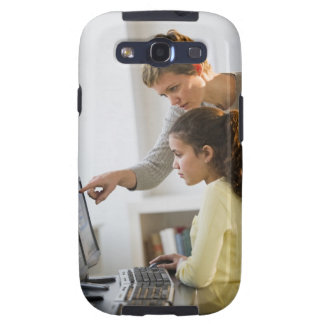 Teacher helping student in computer lab galaxy SIII cases