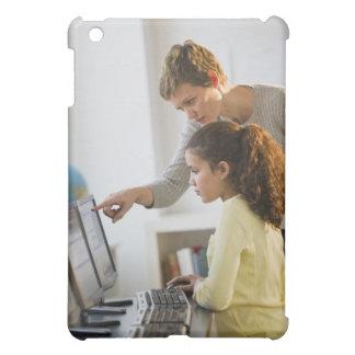 Teacher helping student in computer lab iPad mini case