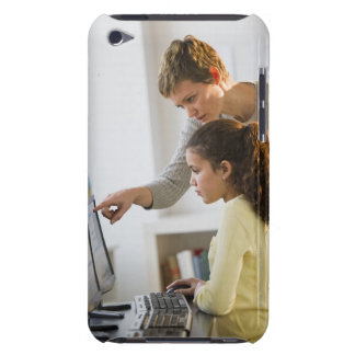 Teacher helping student in computer lab iPod touch Case-Mate case