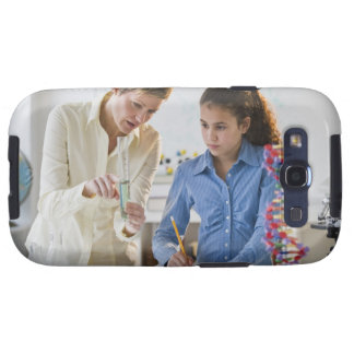 Teacher helping student in science lab galaxy SIII cases