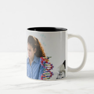 Teacher helping student in science lab Two-Tone mug