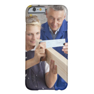Teacher helping student measuring planed wood in barely there iPhone 6 case