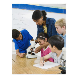Teacher helping students use microscope in postcard