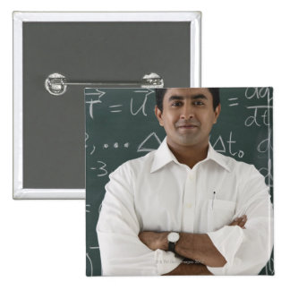 teacher standing in front of chalkboard, arms 15 cm square badge
