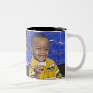 Teacher with toddler in daycare coffee mugs