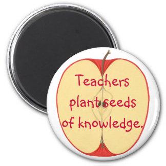 Teachers plant seeds of knowledge, apple magnets