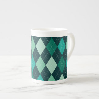 Teal argyle pattern tea cup