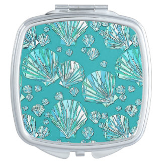 Teal, seafoam sea shells, turquoise background compact mirror