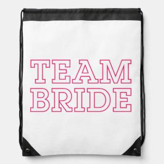 Team Bride Pink Outline Drawstring Bags