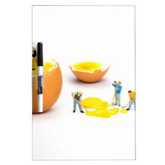 Team of miniature human figurines transporting egg dry erase white board