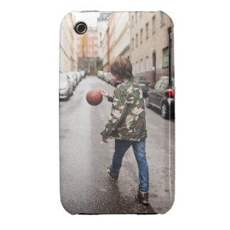 Teenage boy dribbling basketball iPhone 3 covers