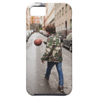Teenage boy dribbling basketball iPhone 5 cover
