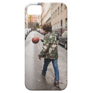 Teenage boy dribbling basketball case for the iPhone 5