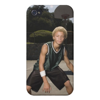 Teenage boy on basketball court iPhone 4 covers
