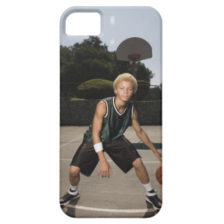 Teenage boy on basketball court iPhone 5 cases