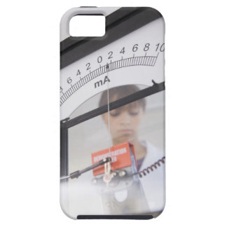 Teenage girl by science equipment iPhone 5 cover