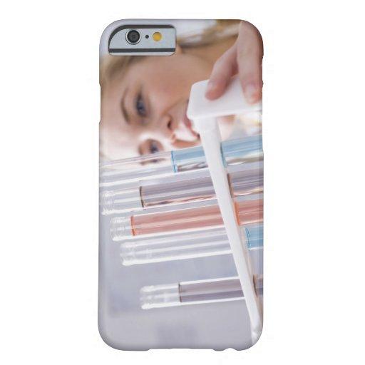 Teenage girl holding rack of test tubes iPhone 6 case