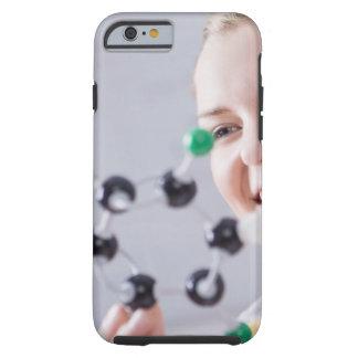 Teenage girl looking at molecule model tough iPhone 6 case