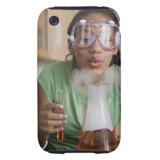 Teenage girl performing science experiment tough iPhone 3 covers