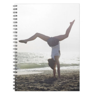 Teenage girl performs gymnastic feat, mom notebooks