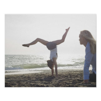 Teenage girl performs gymnastic feat, mom print