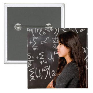 Teenage girl student at blackboard with math 15 cm square badge