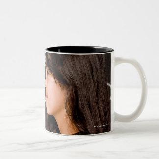 Teenage girl student at blackboard with math Two-Tone coffee mug