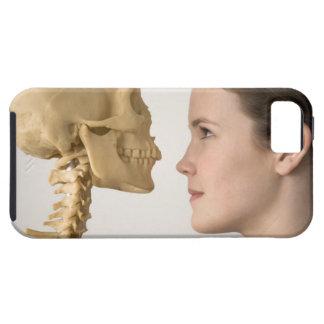 Teenage girl with skeleton tough iPhone 5 case