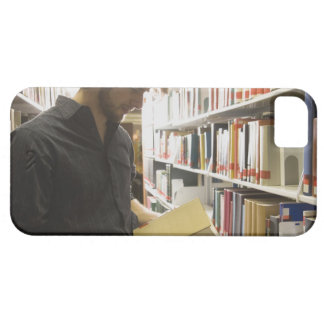 Teenage student in library case for the iPhone 5