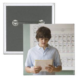 Teenaged boy giving speech in science class pin