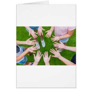 Ten arms of children in circle with palms of hands card