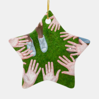 Ten arms of children in circle with palms of hands ceramic ornament