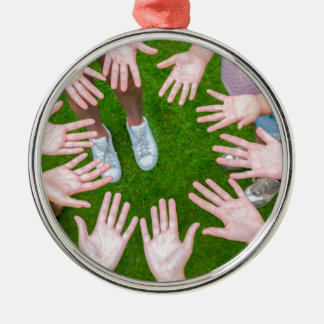 Ten arms of children in circle with palms of hands metal ornament
