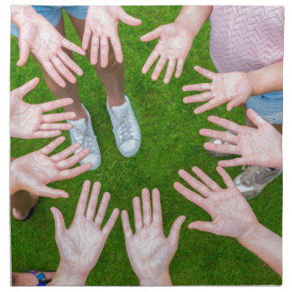 Ten arms of children in circle with palms of hands napkin