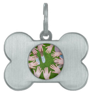 Ten arms of children in circle with palms of hands pet name tag