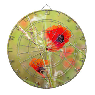 Tender shot of red poppies on the field dartboard