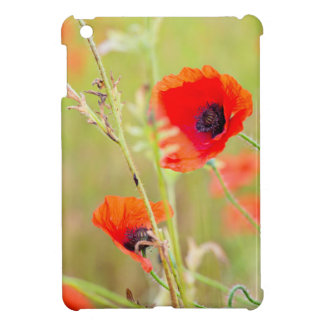 Tender shot of red poppies on the field iPad mini covers