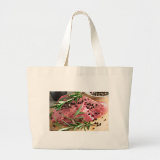 Tenderloin of raw beef with herbs and spices large tote bag