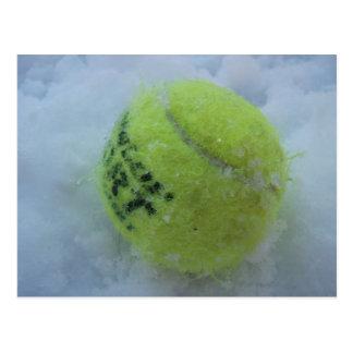 Tennis ball in the snow postcard