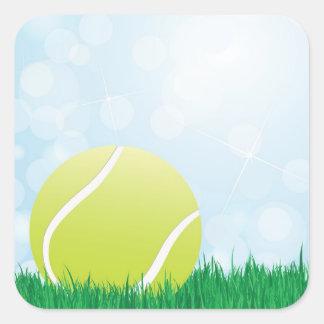 tennis ball on grass square sticker