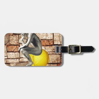 Tennis ball with thinker statue luggage tag