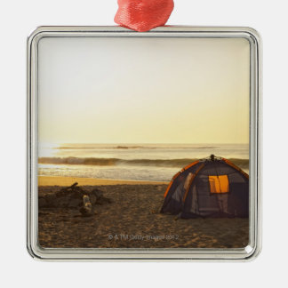 Tent and Burned out Campfire on the Beach. Metal Ornament
