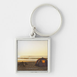 Tent and Burned out Campfire on the Beach. Silver-Colored Square Key Ring