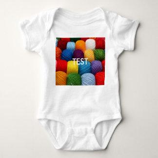 testing yarn baby bodysuit