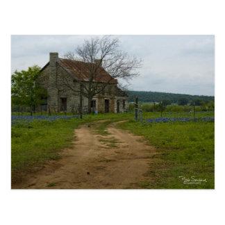 Texas farm house with bluebonnets post card
